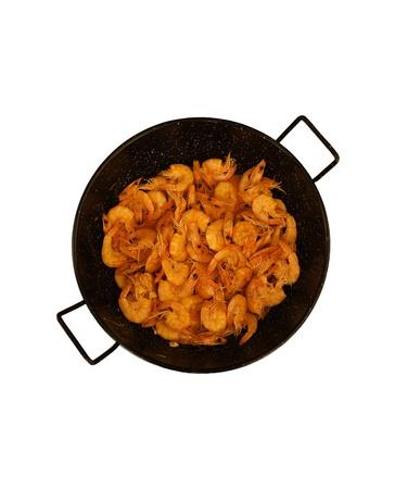dinne: shrimps in black saucepan isolated