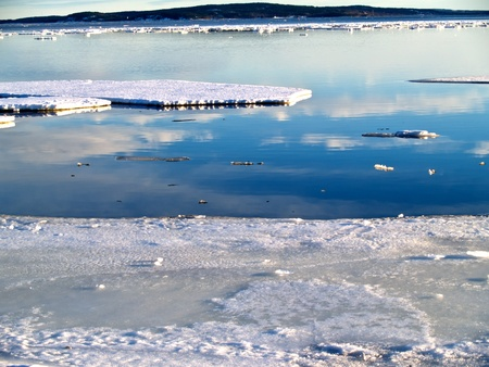 Baltic sea becoming free of ice, Sundsvall, northern Sweden photo
