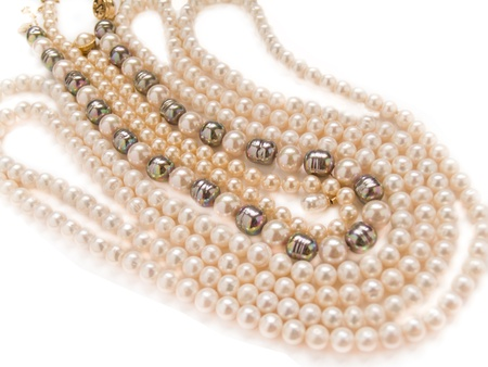 pearls necklaces jewelry, isolated over white background  photo