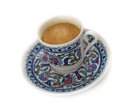coffee in beautiful national turkish small cup isolated over white  photo
