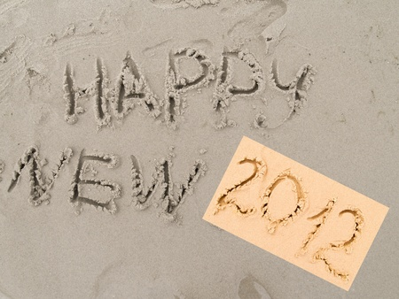 written on sand happy new 2012 new year sign Stock Photo - 10058118