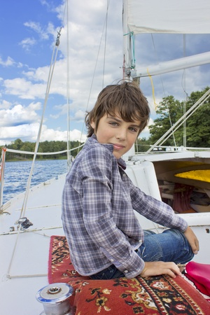 tween boy: kid sailing on yacht