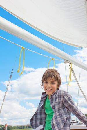 kid sailing on yacht Stock Photo - 10277289