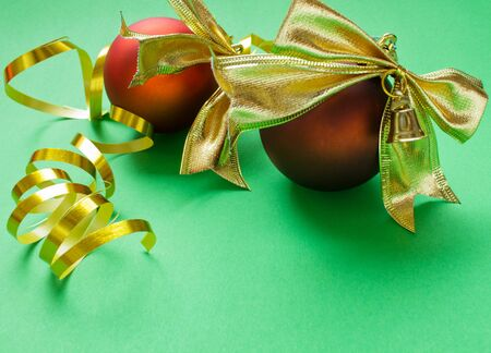 chrismas decorations of red ball and gold tinsell  photo
