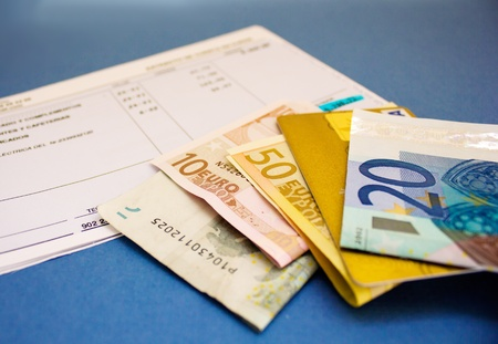 debet: pile of euro baknotes  with plastic card  on bank account Stock Photo