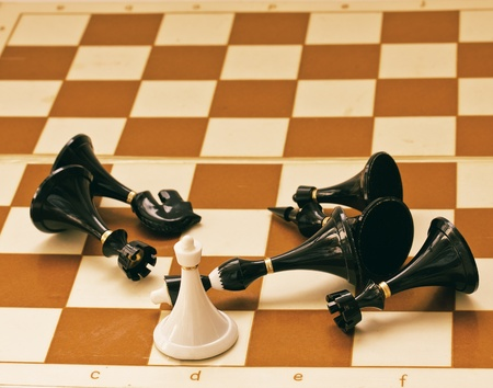 gamesmanship: White chess pawn become a queen defiting enemies Stock Photo