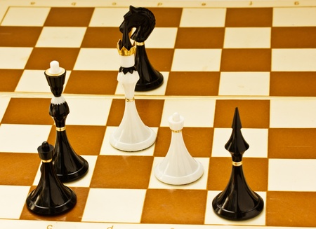 outwit: Black chess beats white king and pawn on board
