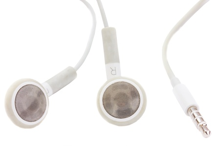small earphones with  jack isolated on white background Stock Photo - 10604072