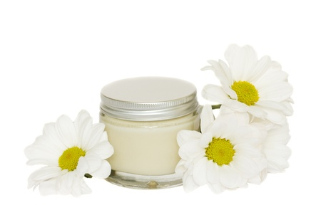 l natural: jar with cream and camomile Stock Photo