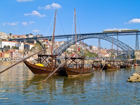 old Porto and traditional boats with wine barrels, Portugal  photo