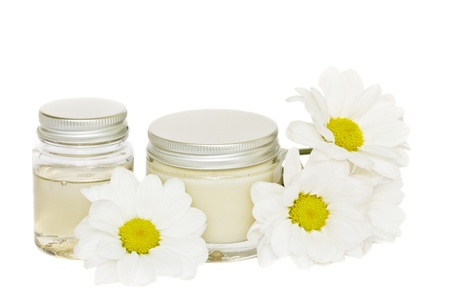 jars with cream and camomile isolated on white background Stock Photo - 10804635