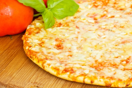 formagi: pizaa quatrro fromaggi (four cheese) with fresh tomatoes