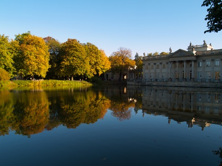 lazienki: old lazenki royal palace over pond in golden autumn Stock Photo