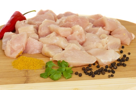 choped raw chicken meat slices with spices Stock Photo - 11259189