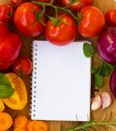 blank notebook for recipes with colorful vegetables