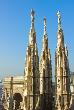 gothic spires  on roof of Duomo (cathedral), Milan, Italy photo