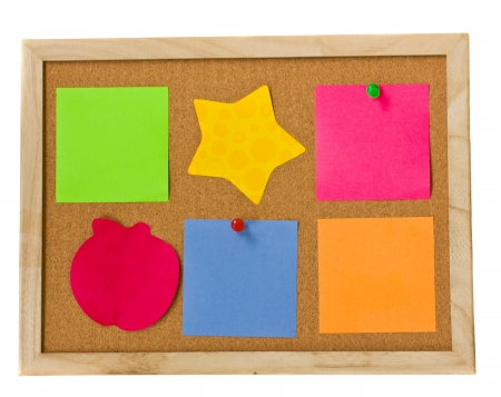 cork board: many colourful notes on cork board isolated over white