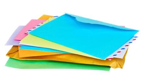 Pile of colorful envelopes isolated on white background photo