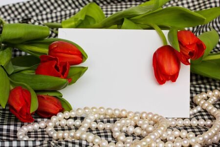 Red tulips with blank invitation card photo