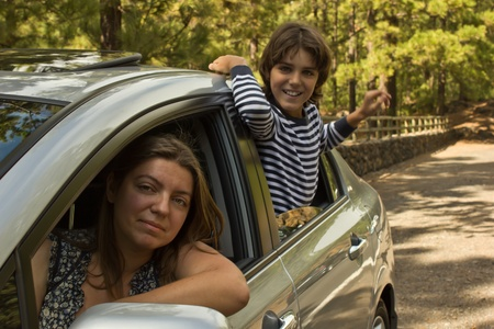 mom amd son traveling together by a car photo