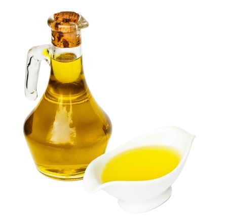 bottle of olive oil with saucer isolated on white background