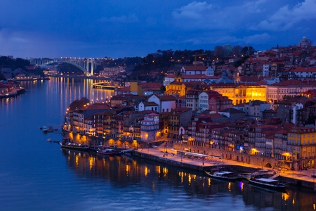 beautiful panorama of Ribeira and Douro river Porto at sunset, Portugal photo