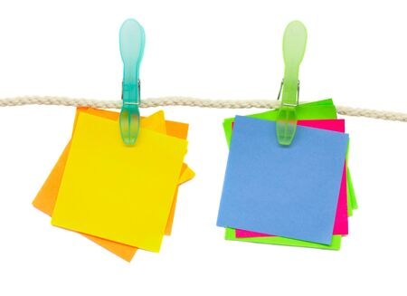 blank multicoloured stickers hanging on rope over white Stock Photo - 12414604