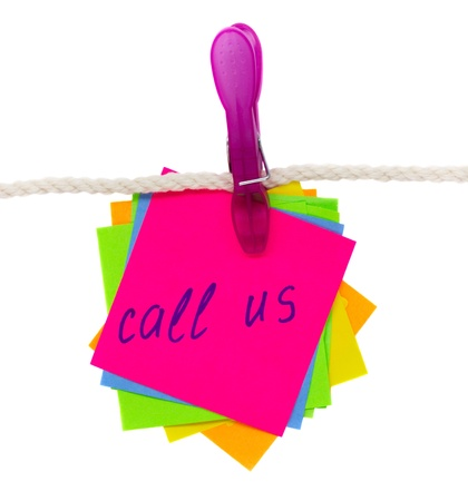 call us written on sticker hanging on rope  isolated on white background Stock Photo - 12414870