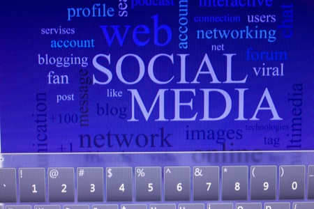 social media and connected words on touch screen tablet-pc Stock Photo - 12706752