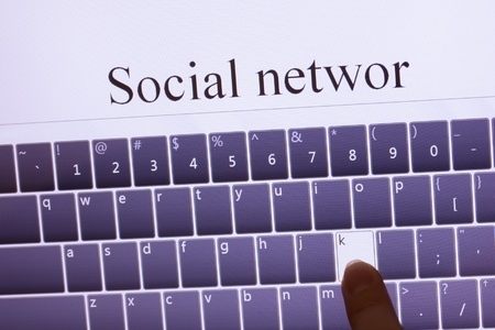 socialnetwork typing on touch screen tablet pc photo