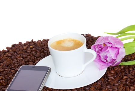 cup of coffee  with  modern smartphone and flower on beans Stock Photo - 12706782
