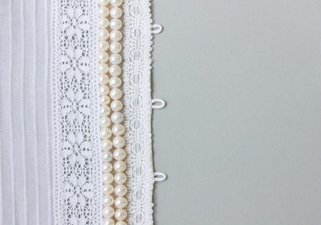 Wedding background with lace and pearl beads  photo