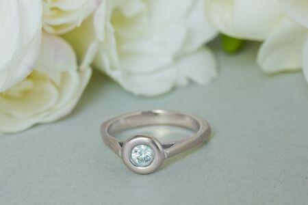diamond wedding ring with tender white flowers photo