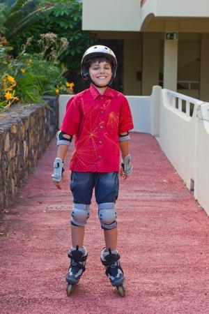 rollerblading: happy boy in roller blades grear scating