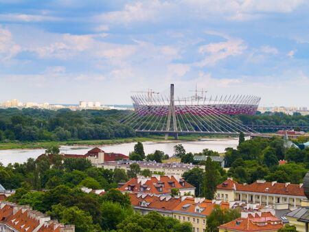 Panorama of Warsaw in Poland, on the first plan Srodmiescie district, farther Prague district with National Stadium Stock Photo - 12950555