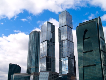 skyscrapers cityscape tops on sky with cloud background photo