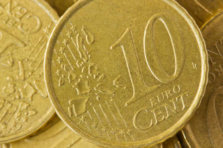 euro yellow coin 10 cent close up  photo