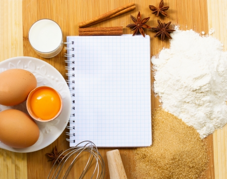 notebook for recipes with raw baking ingredients photo