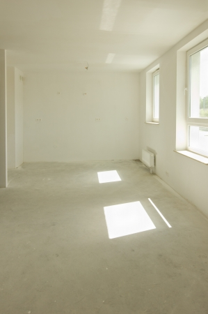 Empty room under construction in a new constructed building photo