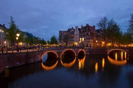 famous canals and bridgres  of Amsterdam in night, Netherlands Stock Photo - 14165390