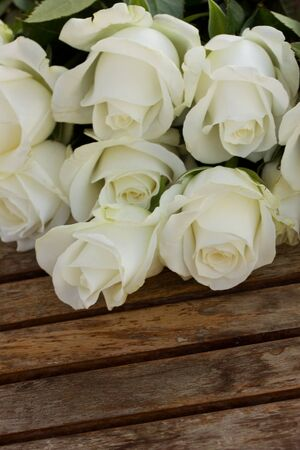 bouquet of white roses  on wooden table photo