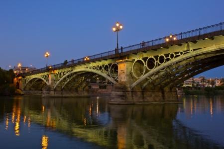 Triana Bridge at night, the oldest bridge of Seville, Spain Stock Photo - 14509125