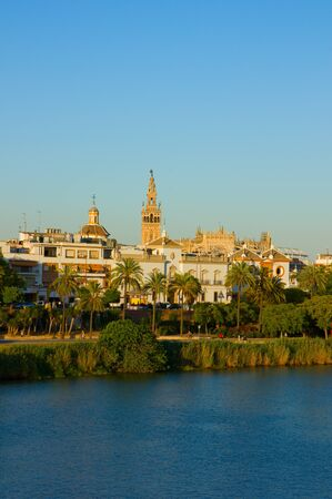 cityscape of Seville on river Guadalquivir, Spain photo