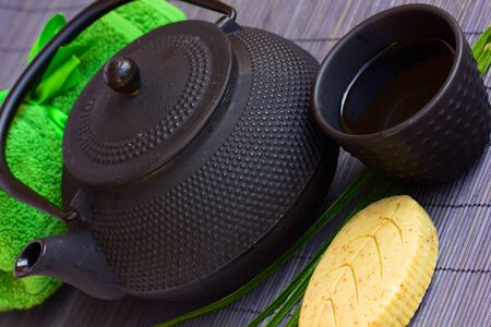 asian tea set and spa settings on bamboo mat photo