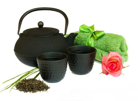 asian tea set with flower and towels isolated on white background photo