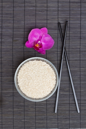 asian food concept - plate with rice and chopsticks photo