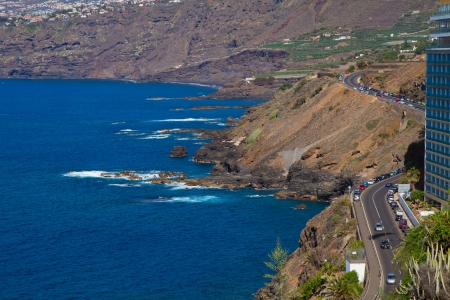 ocean coast and winding road at Puerto de la Cruz, Tenerife, Spain photo
