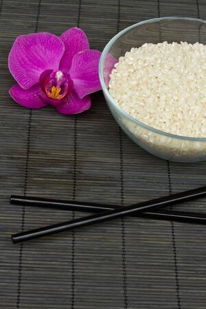 plate with rice and chopsticks - asian food condept photo
