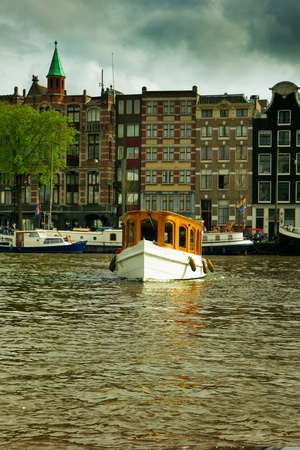 houses and boats on Amsterdam canals, Netherlands  HDR Stock Photo - 15030130