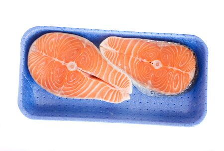 raw salmon steaks in tray  isolated on white background photo
